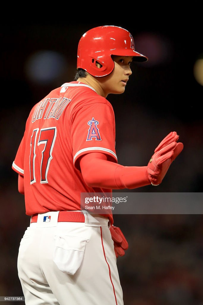 Shohei Ohtani #17 of the Los Angeles Angels of Anaheim looks on during a game against the Cleveland Indians at Angel Stadium on April 3, 2018 in Anaheim, California.