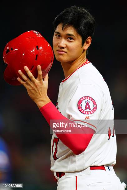 Shohei Ohtani of the Los Angeles Angels of Anaheim looks on during the game against the Texas Rangers at Angel Stadium on September 25 2018 in...