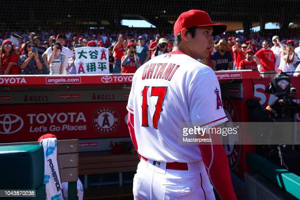 Shohei Ohtani of the Los Angeles Angels of Anaheim looks on during the game against the Oakland Athletics at Angel Stadium on September 30 2018 in...