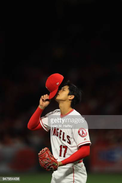 Shohei Ohtani of the Los Angeles Angels of Anaheim looks on during the second inning of a game against the Boston Red Sox at Angel Stadium on April...