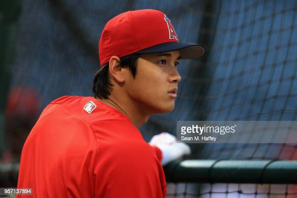 Shohei Ohtani of the Los Angeles Angels of Anaheim looks on during batting practice prior to a game against the Minnesota Twins at Angel Stadium on...