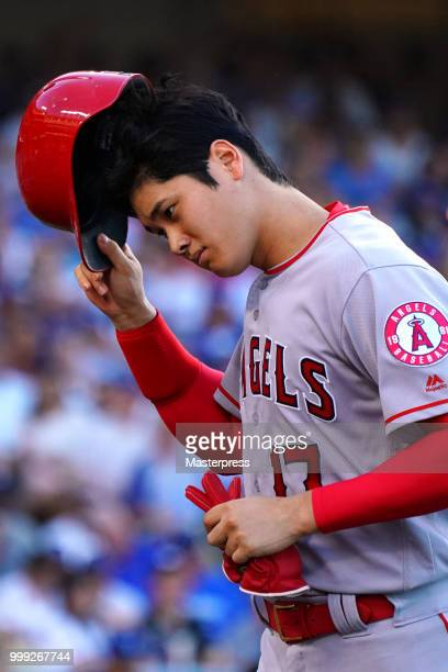 Shohei Ohtani of the Los Angeles Angels of Anaheim looks on during the MLB game against the Los Angeles Dodgers at Dodger Stadium on July 14 2018 in...