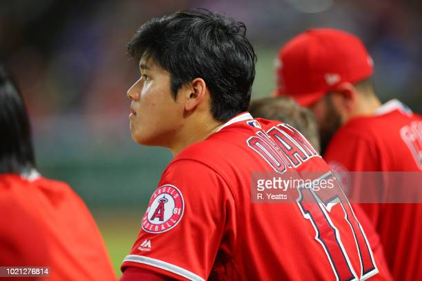 Shohei Ohtani of the Los Angeles Angels of Anaheim looks on from dugout in the eighth inning against the Texas Rangers at Globe Life Park in...