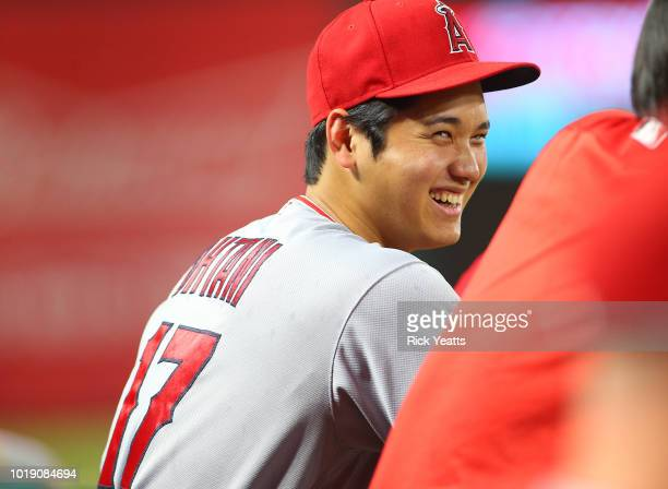Shohei Ohtani of the Los Angeles Angels of Anaheim looks on from the dugout in the first inning against the Texas Rangers at Globe Life Park in...