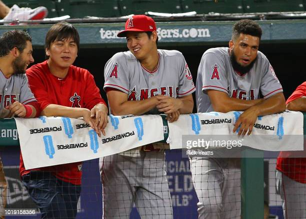 Shohei Ohtani of the Los Angeles Angels of Anaheim looks on from the dugout during the game in the ninth inning against the Texas Rangers at Globe...