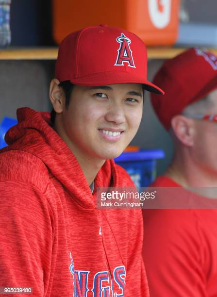 Shohei Ohtani of the Los Angeles Angels of Anaheim looks on from the dugout during the 8th inning of the game against the Detroit Tigers at Comerica...