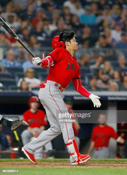 Shohei Ohtani of the Los Angeles Angels of Anaheim loses his helmet while batting in sixth inning against the New York Yankees at Yankee Stadium on...