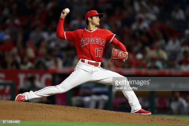 Shohei Ohtani of the Los Angeles Angels of Anaheim pitches during a game against the Kansas City Royals at Angel Stadium on June 6 2018 in Anaheim...