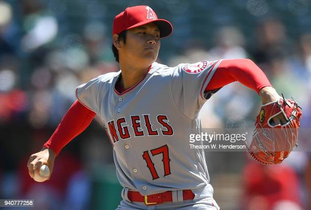 Shohei Ohtani of the Los Angeles Angels of Anaheim pitches in the bottom of the first inning of his Major League pitching debut against the Oakland...