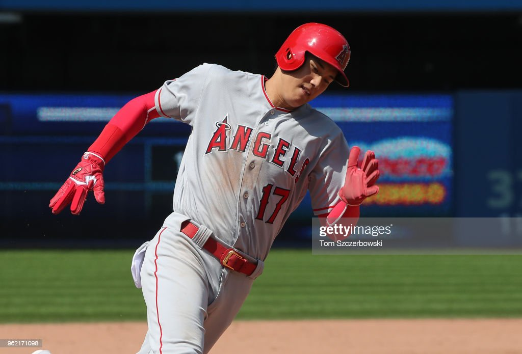 Shohei Ohtani #17 of the Los Angeles Angels of Anaheim races around third base to score a run on an RBI single by Andrelton Simmons #2 in the ninth inning during MLB game action against the Toronto Blue Jays at Rogers Centre on May 24, 2018 in Toronto, Canada.