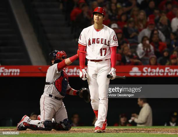 Shohei Ohtani of the Los Angeles Angels of Anaheim reacts after a swing and a miss on a pitch during the fourth inning of the MLB game against the...