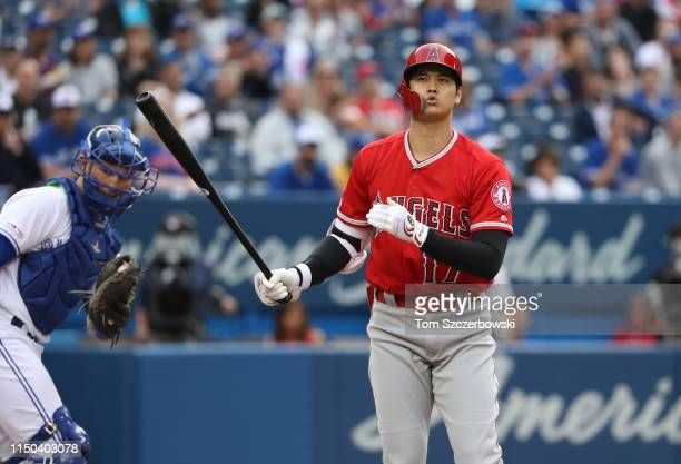 Shohei Ohtani of the Los Angeles Angels of Anaheim reacts after striking out in the first inning during MLB game action against the Toronto Blue Jays...