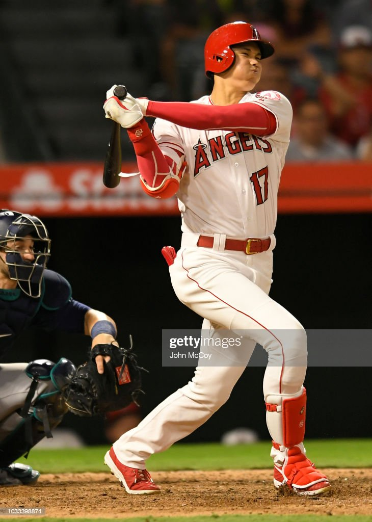 Shohei Ohtani #17 of the Los Angeles Angels of Anaheim reacts to fouling the ball off of his foot against the Seattle Mariners in the eighth inning at Angel Stadium on September 14, 2018 in Anaheim, California.