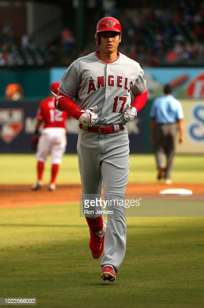 Shohei Ohtani of the Los Angeles Angels of Anaheim returns to the dugout after flying out against the Texas Rangers during the eighth inning at Globe...