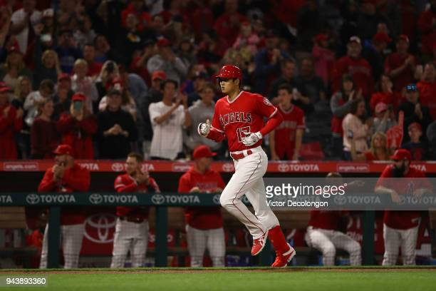 Shohei Ohtani of the Los Angeles Angels of Anaheim rounds the base on his solo home run during the second inning of the MLB game against the Oakland...