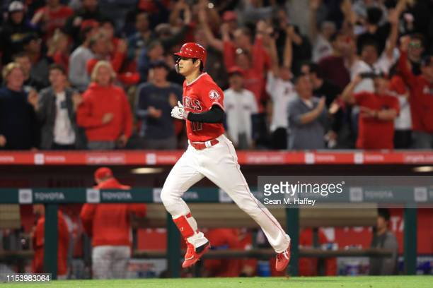 Shohei Ohtani of the Los Angeles Angels of Anaheim runs home after hitting three-run homerun during the fourth inning of a game against the Oakland...