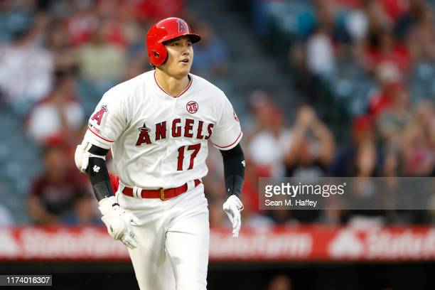 Shohei Ohtani of the Los Angeles Angels of Anaheim runs to first after hitting a solo homerun during the fifth inning of a game against the Cleveland...