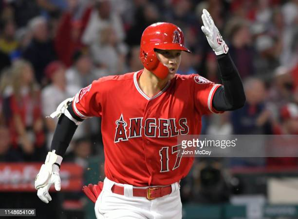 Shohei Ohtani of the Los Angeles Angels of Anaheim runs to first base after he hit a home run against Yusei Kikuchi of the Seattle Mariners in the...