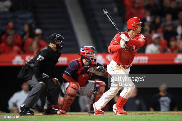 Shohei Ohtani of the Los Angeles Angels of Anaheim runs to first base after hitting a single during the eighth inning of a game against the Cleveland...
