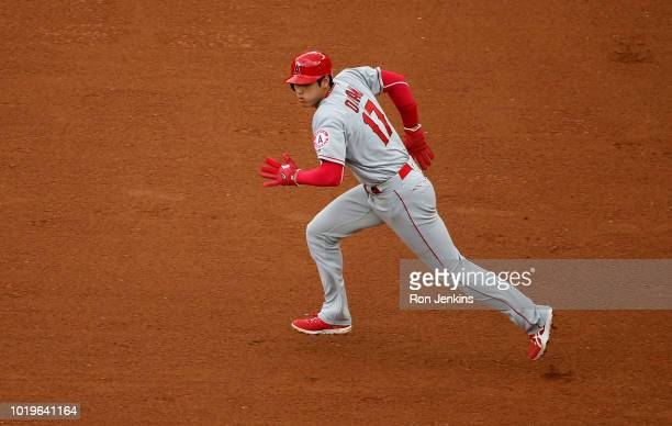 Shohei Ohtani of the Los Angeles Angels of Anaheim runs toward second base against the Texas Rangers during the sixth inning at Globe Life Park in...