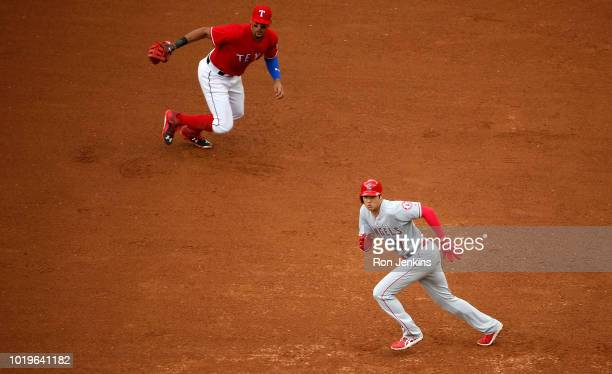 Shohei Ohtani of the Los Angeles Angels of Anaheim runs toward second base as Ronald Guzman of the Texas Rangers looks on during the sixth inning at...