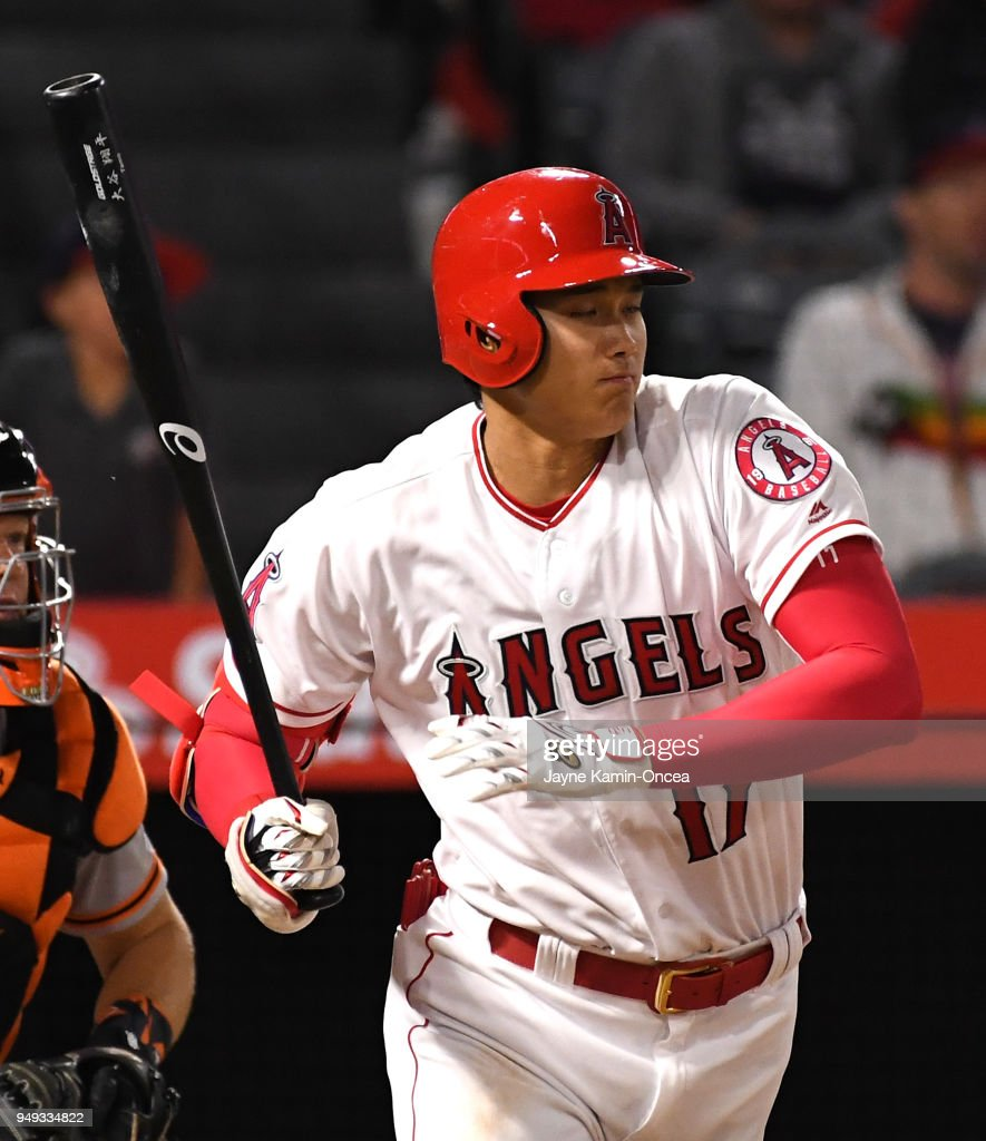 Shohei Ohtani #17 of the Los Angeles Angels of Anaheim singles in the ninth inning of the game against the San Francisco Giants at Angel Stadium of Anaheim on April 20, 2018 in Anaheim, California.