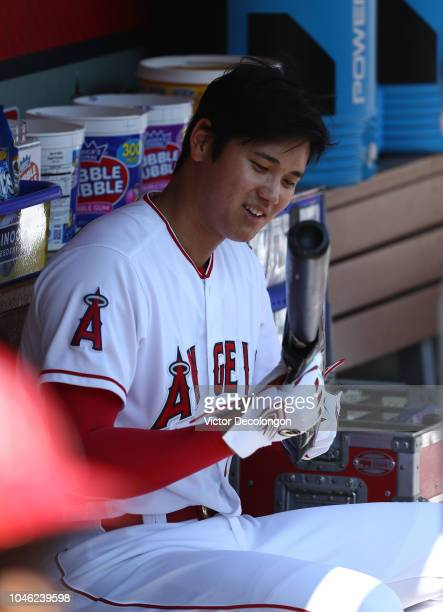 Shohei Ohtani of the Los Angeles Angels of Anaheim sits in the dugout prior to the MLB game against the Oakland Athletics at Angel Stadium on...