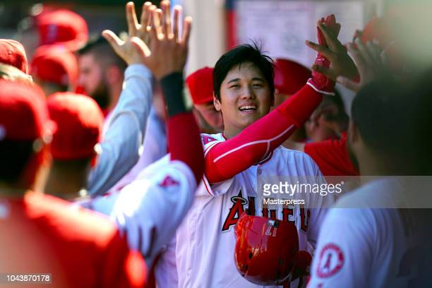 Shohei Ohtani of the Los Angeles Angels of Anaheim smiles during the game against the Oakland Athletics at Angel Stadium on September 30 2018 in...