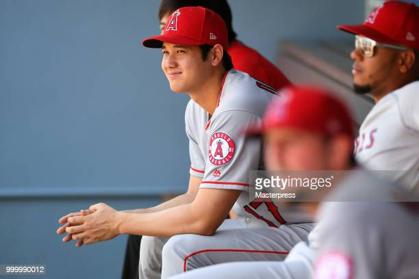 Shohei Ohtani of the Los Angeles Angels of Anaheim smiles during the MLB game against the Los Angeles Dodgers at Dodger Stadium on July 15 2018 in...