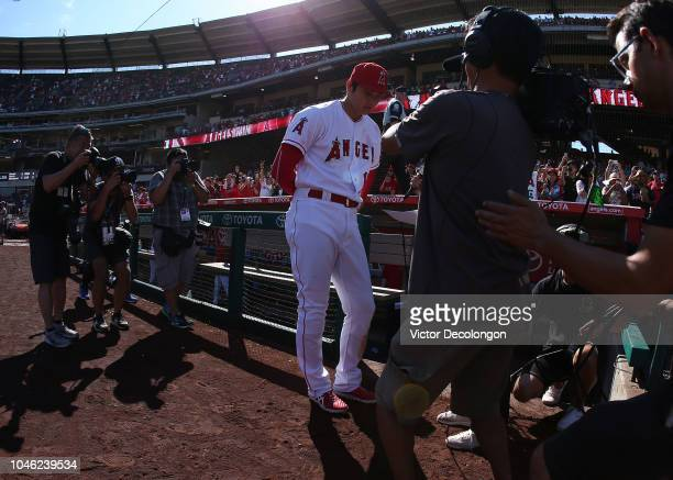 Shohei Ohtani of the Los Angeles Angels of Anaheim speaks with the Japanese media after the MLB game against the Oakland Athletics at Angel Stadium...
