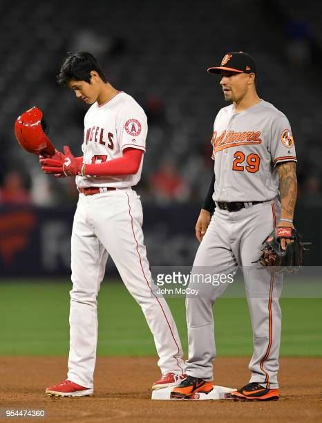Shohei Ohtani of the Los Angeles Angels of Anaheim stands next to Jace Peterson of the Baltimore Orioles at second base after a double in the fourth...