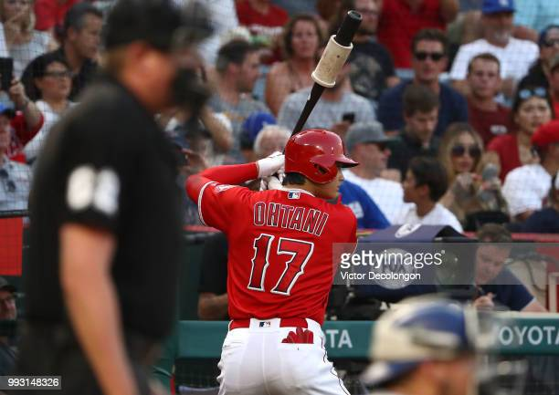 Shohei Ohtani of the Los Angeles Angels of Anaheim stands ondeck in the second inning prior to this atbat during the MLB game against the Los Angeles...