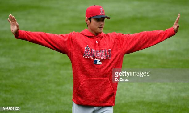 Shohei Ohtani of the Los Angeles Angels of Anaheim stretches as he warms up prior to a game against the Kansas City Royals at Kauffman Stadium on...