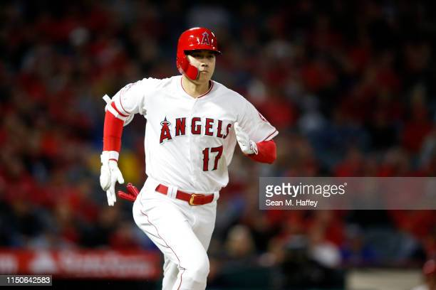 Shohei Ohtani of the Los Angeles Angels of Anaheim strikes out and runs to first on a pass ball during the sixth inning of a game against the...