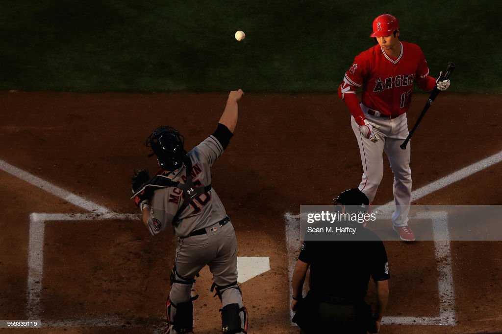 Shohei Ohtani #17 of the Los Angeles Angels of Anaheim strikes out as Brian McCann #16 of the Houston Astros throws back to the pitcher during the first inning of a game against the Houston Astros at Angel Stadium on May 16, 2018 in Anaheim, California.