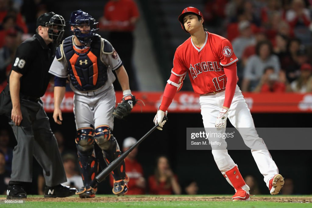Shohei Ohtani #17 of the Los Angeles Angels of Anaheim strikes out as Brian McCann #16 of the Houston Astros looks on during the sixth inning of a game at Angel Stadium on May 16, 2018 in Anaheim, California.