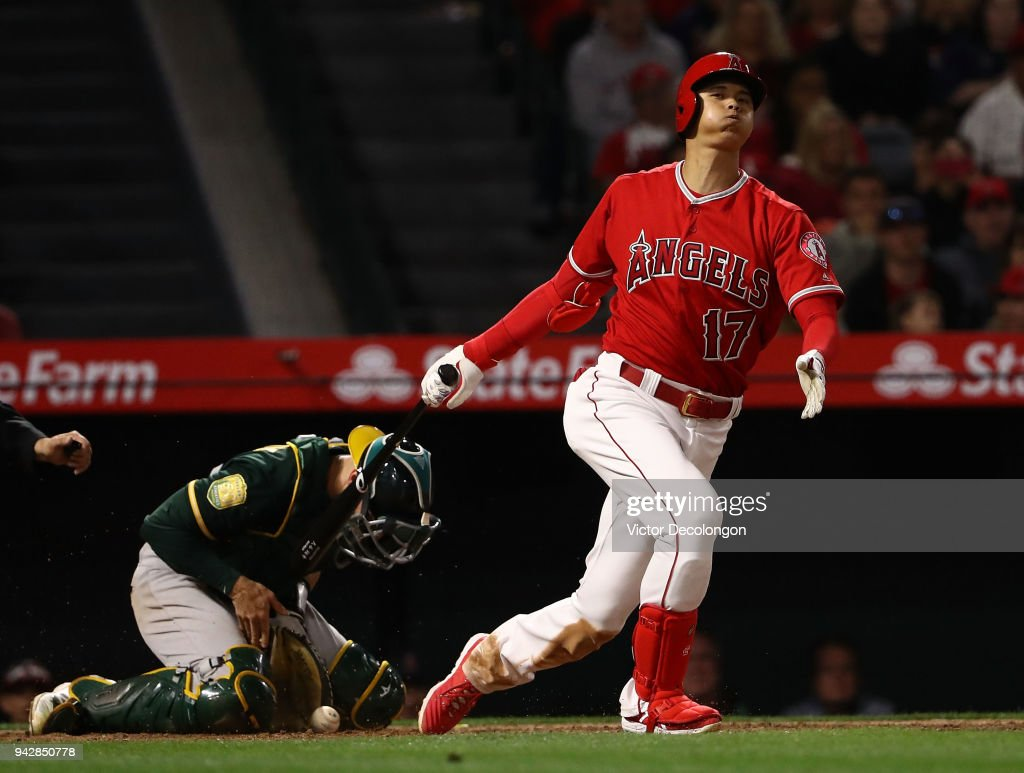 Shohei Ohtani #17 of the Los Angeles Angels of Anaheim strikes out in the eighth inning during the MLB game at Angel Stadium on April 6, 2018 in Anaheim, California. The Angels defeated the Athletics 13-9.