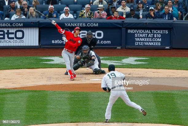 Shohei Ohtani of the Los Angeles Angels of Anaheim strikes out in the first inning against Masahiro Tanaka of the New York Yankees at Yankee Stadium...