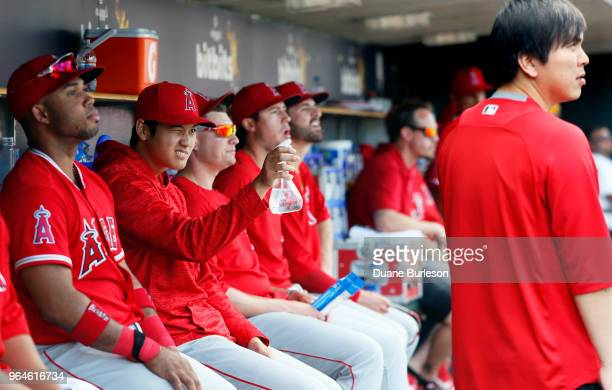Shohei Ohtani of the Los Angeles Angels of Anaheim takes aim at his interpreter Ippei Mizuhara with a spray bottle during the eighth inning of a game...