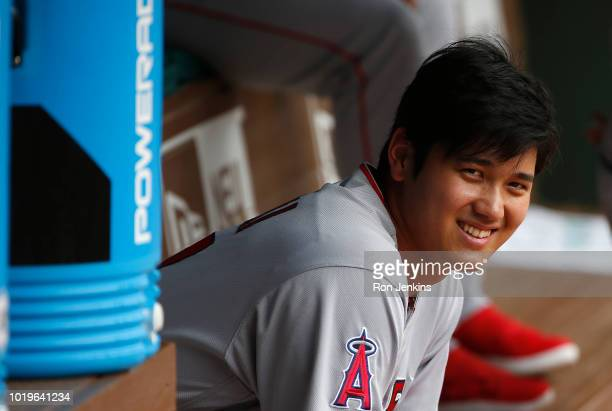 Shohei Ohtani of the Los Angeles Angels of Anaheim waits in the dugout before the game against the Texas Rangers at Globe Life Park in Arlington on...