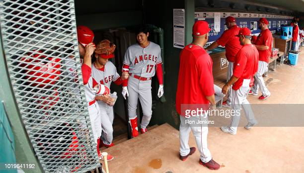 Shohei Ohtani of the Los Angeles Angels of Anaheim waits in the dugout with teammates before the game against the Texas Rangers at Globe Life Park in...
