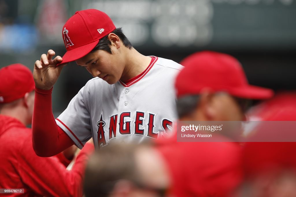 Shohei Ohtani #17 of the Los Angeles Angels of Anaheim walks back to the dugout after pitching in the third inning against the Seattle Mariners at Safeco Field on May 6, 2018 in Seattle, Washington. The Los Angeles Angels of Anaheim won 8-2 over the Seattle Mariners.
