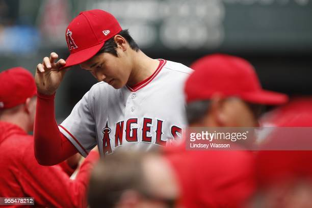Shohei Ohtani of the Los Angeles Angels of Anaheim walks back to the dugout after pitching in the third inning against the Seattle Mariners at Safeco...