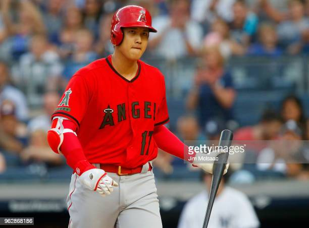 Shohei Ohtani of the Los Angeles Angels of Anaheim walks back to the dugout after striking out to end the first inning against the New York Yankees...