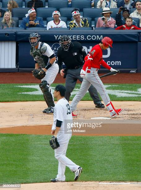 Shohei Ohtani of the Los Angeles Angels of Anaheim walks back to the dugout after striking out in the first inning against Masahiro Tanaka of the New...