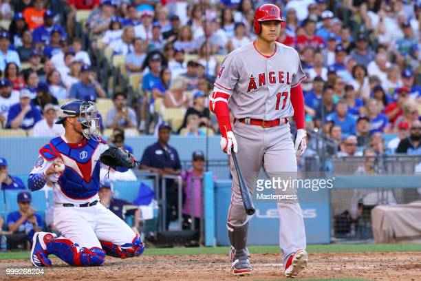 Shohei Ohtani of the Los Angeles Angels of Anaheim walks to first base after drawing a walk on his at bat during the MLB game against the Los Angeles...