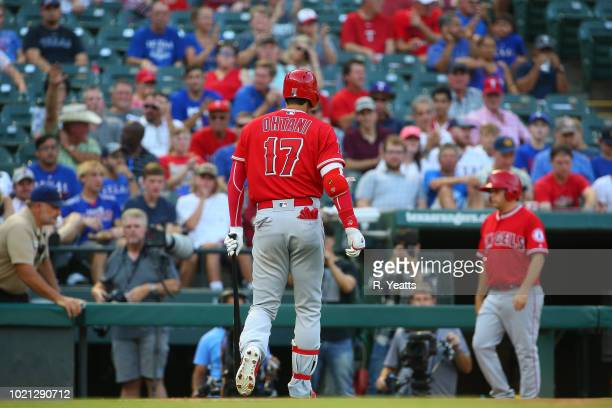 Shohei Ohtani of the Los Angeles Angels of Anaheim walks to the dugout after striking out in the first inning against the Texas Rangers at Globe Life...