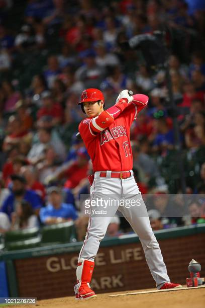 Shohei Ohtani of the Los Angeles Angels of Anaheim warms up in the seventh inning against the Texas Rangers at Globe Life Park in Arlington on August...