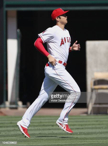 Shohei Ohtani of the Los Angeles Angels of Anaheim warms up prior to the MLB game against the Oakland Athletics at Angel Stadium on September 30 2018...
