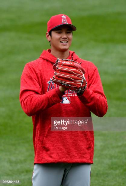 Shohei Ohtani of the Los Angeles Angels of Anaheim warms up prior to a game against the Kansas City Royals at Kauffman Stadium on April 14 2018 in...
